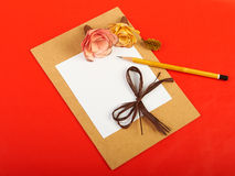 Red background. Card with flowers on red background Stock Photography