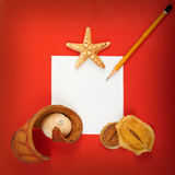 Red background. Card with shells and pencils on red background Royalty Free Stock Images