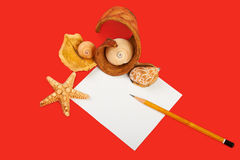 Red background. Card with shells and pencils on red background Stock Photography