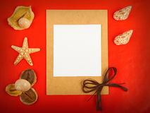 Red background. Card with shells and pencils on red background Stock Images