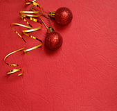 Red background with Christmas balls in a corner Royalty Free Stock Images
