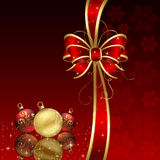 Red background with Christmas baubles Royalty Free Stock Images