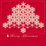Red background Christmas card that have a Christmas tree on it,which is made of shining snow Stock Image