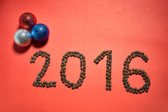 2016 red background with Christmas toys Stock Image