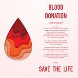 Blood donation background. Red background with cut paper blood blot and sample donation text Stock Photo