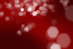 Red background with defocused lights. Creating sparkles Stock Photo
