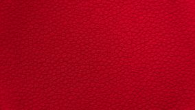 Red background fabric textiles with a small embroidery pattern royalty free stock photography