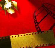 Red background with film strip and reflector Royalty Free Stock Photos
