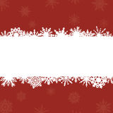 Red background with frame for congratulations and snowflakes Stock Photography