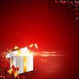 Red background with gift box and jingle bell Stock Photos