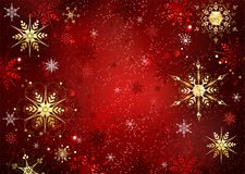 Red background with gold snowflakes Royalty Free Stock Photography