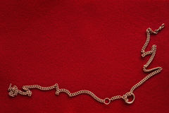 Red background with golden chain Stock Image
