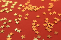Red Background with golden shiny stars Royalty Free Stock Images
