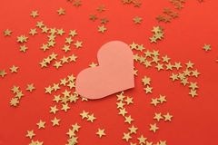 Red background with golden shiny stars and heart Stock Photo
