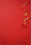 Red background with golden streamer. Red background  with golden streamer in a corner Stock Image