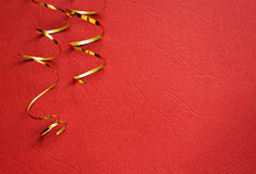 Red background with golden streamers Stock Photography