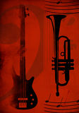 Red background with guitar and trumpet Royalty Free Stock Photos