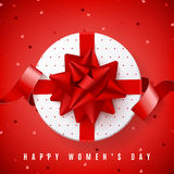 Red background for Happy Women`s Day. Top view on white gift box with red bow. Vector illustration with satin ribbon and confetti Stock Photography