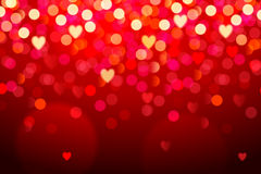 Red background with hearts and bokeh lights Royalty Free Stock Photos