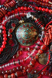 Red background-jewerly. These are beautiful east female ornaments Stock Images