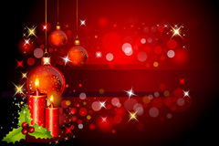 Red background with jingle ball and candles Stock Image