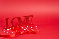 Red background with love sign Stock Images