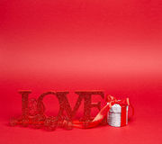 Red background with love sign and gift Royalty Free Stock Images