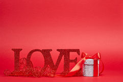 Red background with love sign and gift Stock Photo