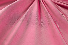 Red background luxury cloth or wavy folds of grunge silk texture satin velvet Royalty Free Stock Image