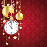 Red Background Ornaments Clock 2017 Golden Baubles. Golden baubles with clock and date 2017 on the red background Stock Photography