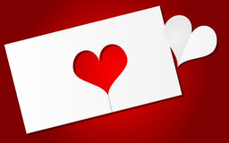 Red background with paper heart. Red backgroudn with cut out paper heart Royalty Free Stock Images