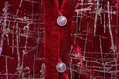 Red texture of red velvet clothes and two buttons royalty free stock photography