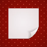 Red background with a sheet of paper Stock Image