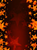 Red background with shining golden stars Royalty Free Stock Image