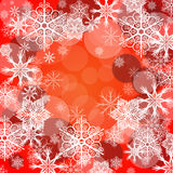 Red background with snowflake Stock Images