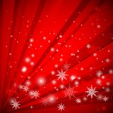 Red background with snowflakes Royalty Free Stock Photos