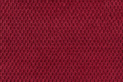 Red background from soft fleecy fabric closeup. Texture of textile macro Royalty Free Stock Images