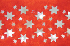 Red background of stars pierced. With bokeh effect Stock Photo