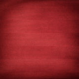 Red background with striped pattern and vignette Stock Photography
