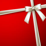 Red background with a white bow Royalty Free Stock Photography