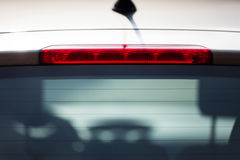 Backlight of a car. The red backlight of a car with the two front seats Royalty Free Stock Photo