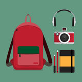 Red backpack with multiple items. Royalty Free Stock Image