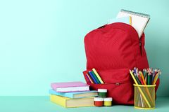 Backpack with school supplies royalty free stock photos