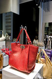 Red bag. Close up view of a leather red bag in a store royalty free stock image