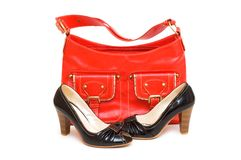 Red bag and black shoes isolated Royalty Free Stock Images