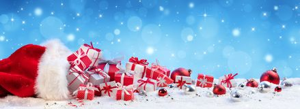 Red Bag With Christmas Present. On Snow royalty free stock photography