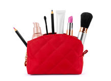 Red bag for cosmetics with a make up accessories on a white back Stock Photos
