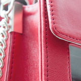 Red bag detail. Stitched detail from a fashionable red bag Stock Image