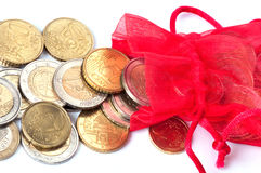 Red bag with euro coins Stock Photos