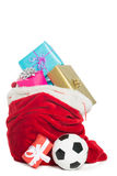 Red bag full of presents Royalty Free Stock Photos